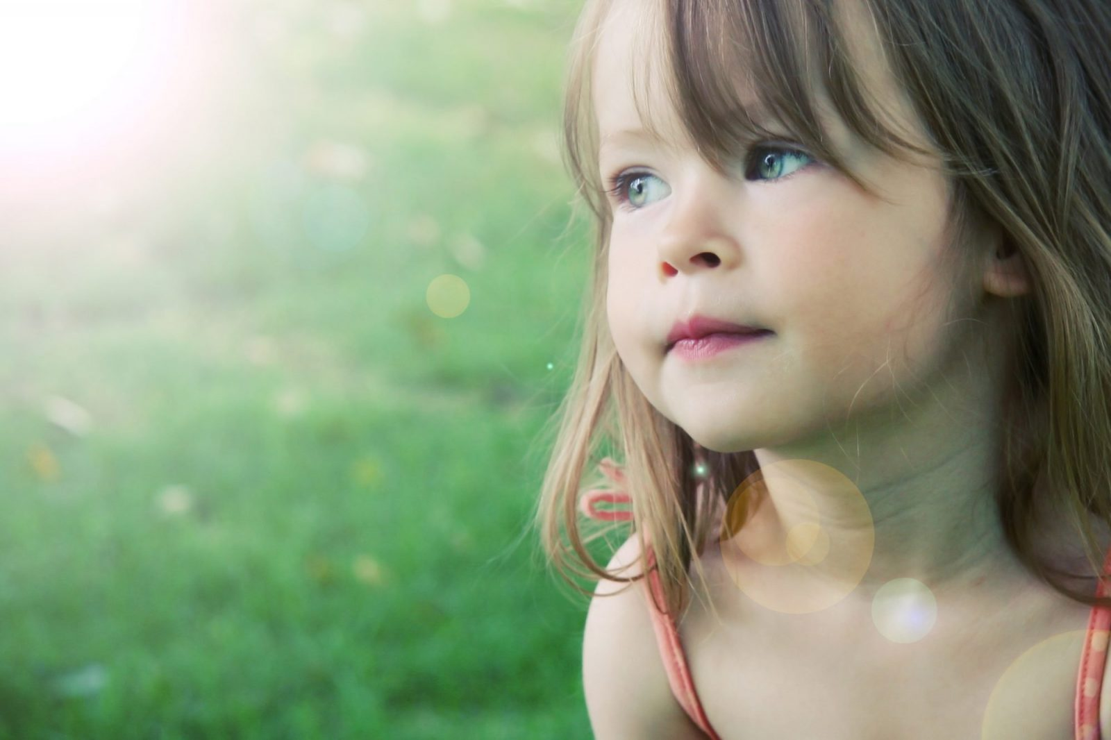 Adorable Little Girl Taken Closeup Outdoors In Summer - Lighting Effect